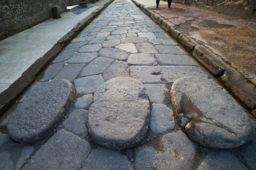 Old street in Pompeii ruins, Italy.