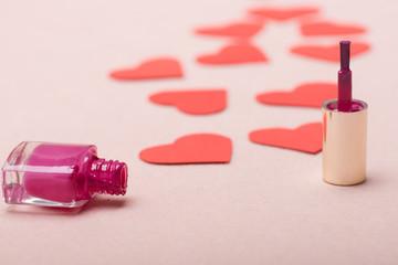Nail polish and lots of paper hearts making path