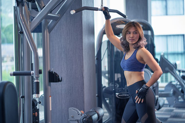 Asian woman exercising in the gym.