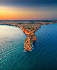 Aerial sunset view over cape Kaliakra with windmills farm, huge cliffs on black sea coast in Bulgaria