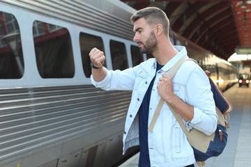 Male showing impatience at the train station