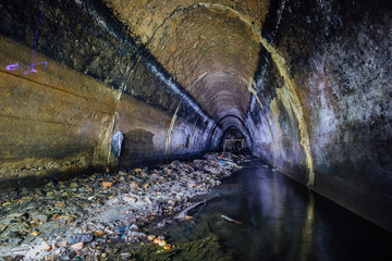 Flooded by wastewater sewage collector. Dirty sewer tunnel under city