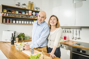 Senior couple in kitchen, portrait