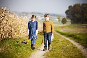 Girl and boy walking on path
