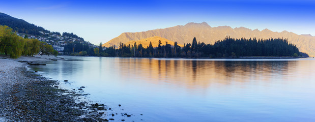 Panoramic beautiful serenity of Lake Wakatipu in Queenstown in Autumn , South Island of New Zealand