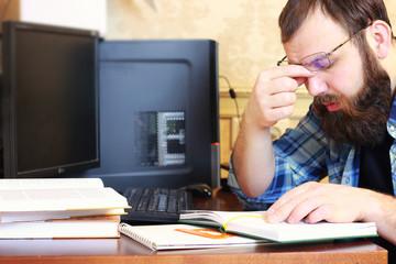man write pen table