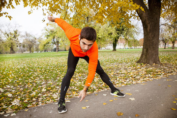 Male runner stretching and warming up