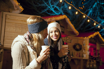 Two women drinking punch at Christmas Market