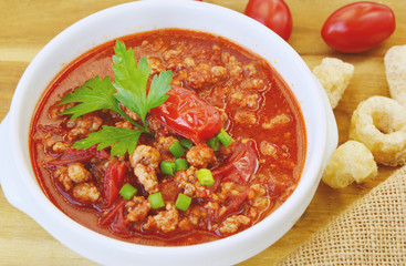 Northern Thai Meat and Tomato Spicy Dip ( Thai name is Nam prik ong) Thai food menu with tomatoes.