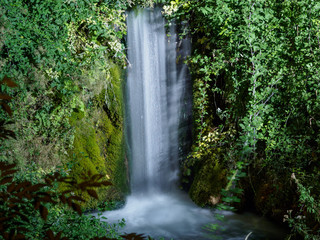 A waterfall, taken at night with a slow shutter in the town of Moustiers-Sainte-Marie, France.
