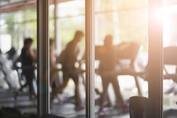 Background blur, gym fitness blur background with background light.