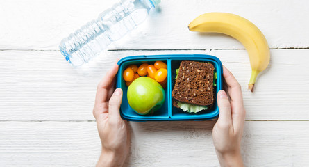 Picture of man's hands with useful lunch