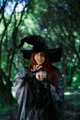 Image of witch in long black hat