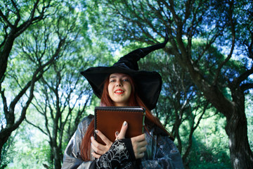 Photo of witch in black hat