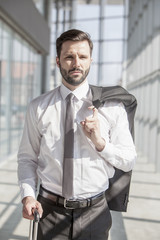 Portrait of businessman in airport