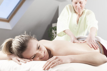 Young woman having back massage