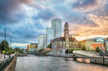 Fototapete - Beautiful cityscape with sunset over canal and skyline in Malmo, Sweden