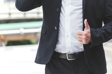 Businessman show thumb up hand sign