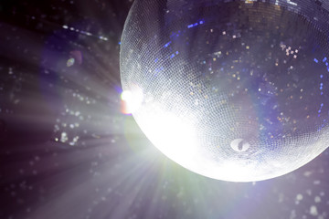 Bright patches of light on disco ball. tinted