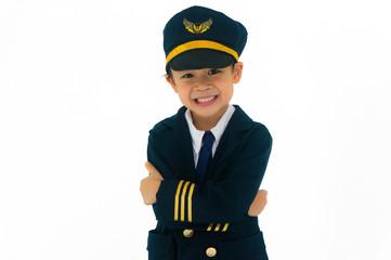 Asian boy wearing pilot uniform, smiling happily. Isolated on white background.