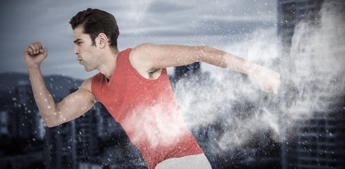 Composite image of male athlete running on white background