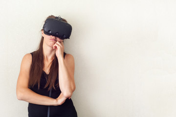 Young attractive caucasian woman using VR-headset glasses