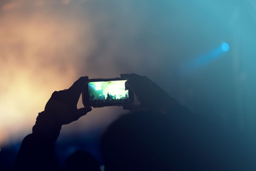 Filming a concert with a phone