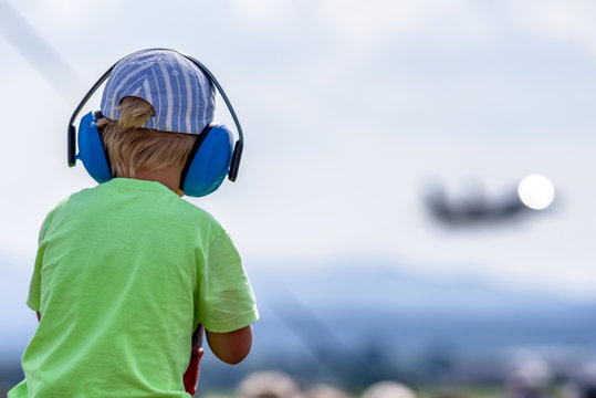 Child with hearing protections