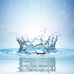 Water splash in dark blue color with a drop of water flying from above