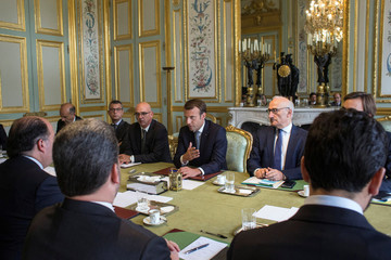 French President Emmanuel Macron talks with President of the Venezuelan parliament Julio Borges during a meeting, at the Elysee Palace in Paris