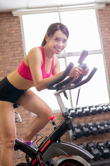 woman use exercise bike