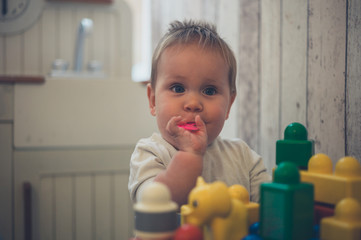 Baby playing in pretend kitchen
