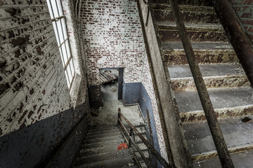 Stairwell with doorway and brick walls