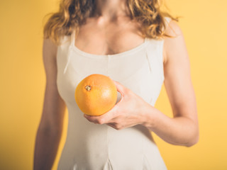 Young woman with grapefruit