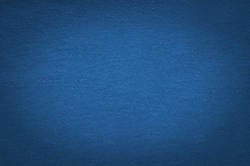 Blue cloth texture Background with black gradient vignette