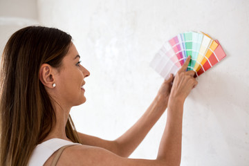 Young pretty woman choosing color for new home
