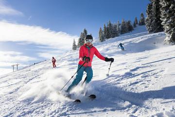 Ski holiday, Group of skiers carving downhill, Sudelfeld, Bavaria, Germany