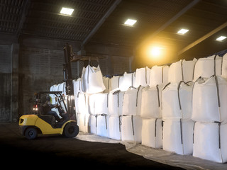 Soda ash in jumbo bags are store in warehouse and handling by forklift