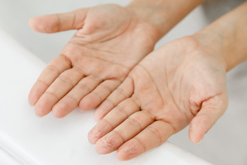 Female hands with wrinkles after bath