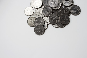American Quarters are on a white table under natural light
