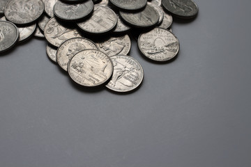American quarters are on a white table