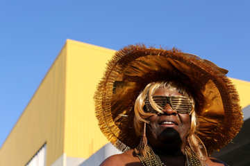 A Mas Camp marcher poses for a picture during J'Ouvert, an overnight-into-dawn celebration ahead of the annual West Indian-American Carnival Day Parade in Brooklyn