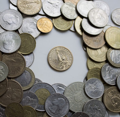 The US coin is surrounded by coins from around the world.