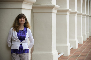 A Woman Stands Amid Spanish Revival Style Architecture