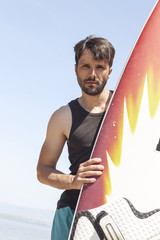 Male surfer, portrait