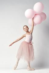 girl ballerina holding pink balloons