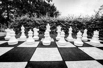 Black and white photo of a game of chess