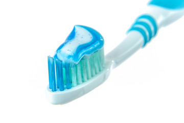 Toothpaste on blue toothbrush