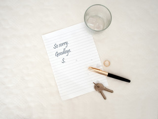 Relationship ends. Breakup, divorce message concept. Tear stained paper.