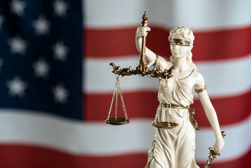 Lady Justice. USA flag background